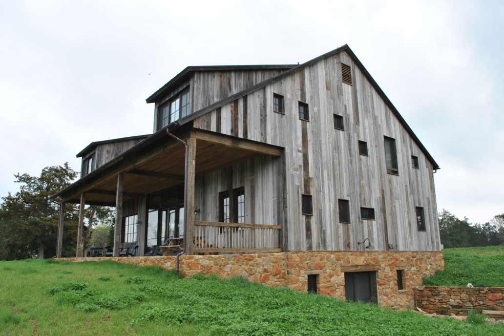External view of the barn with burnished brass windows and doors