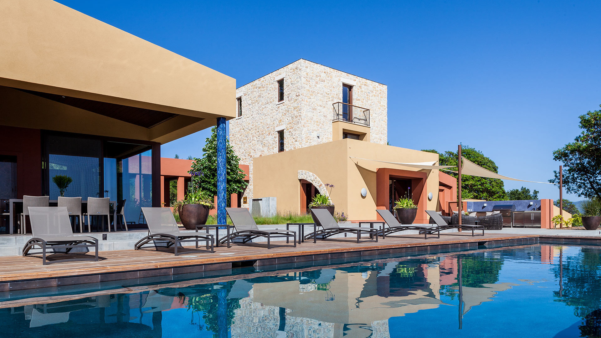 View of the contemporary style Corralitos Villa in front of the winming pool