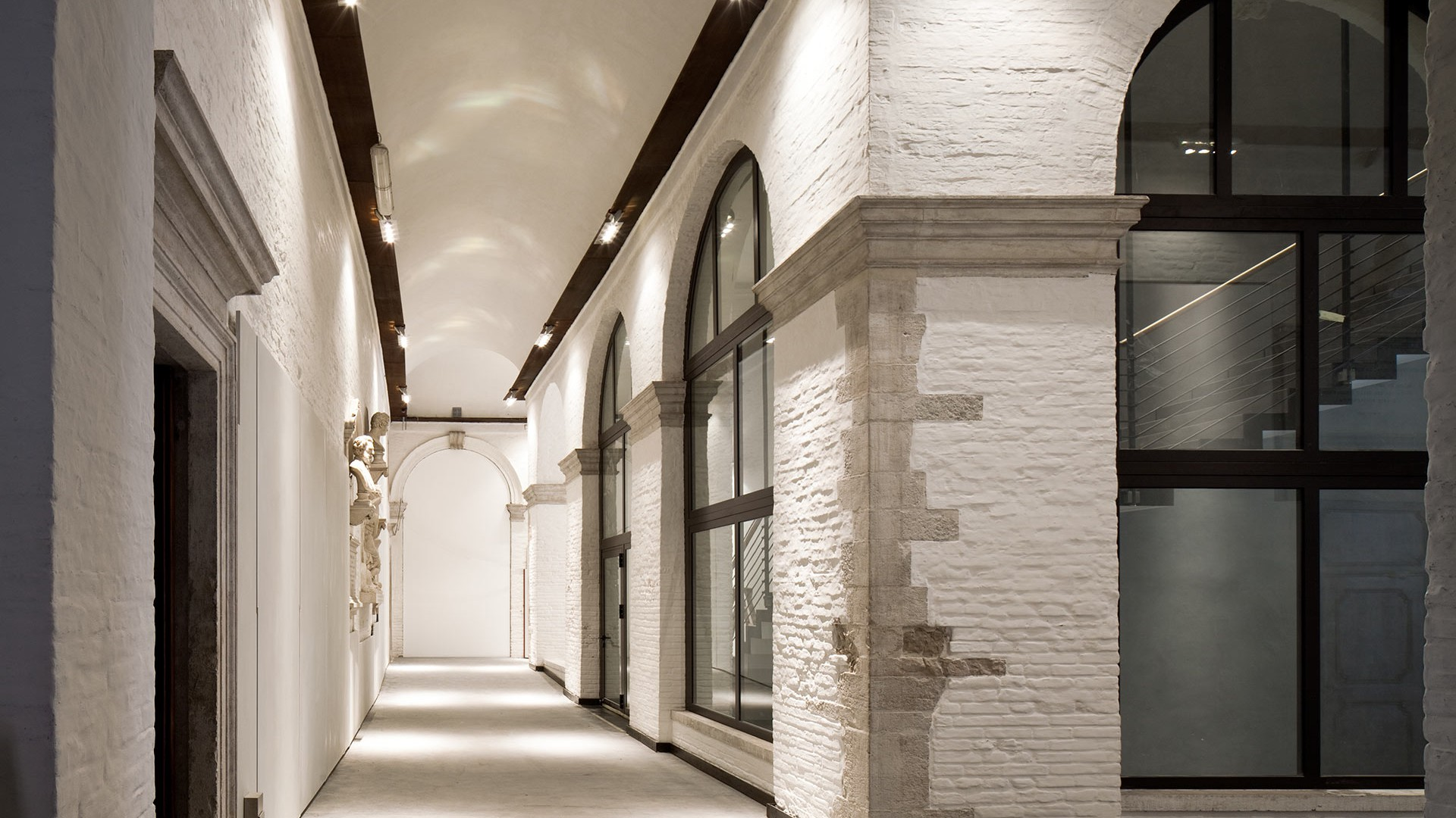 Bronze windows with minimal sightlines inside the Accademia museum in Venice