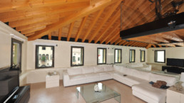 modern attic: burnished brass windows in the living room