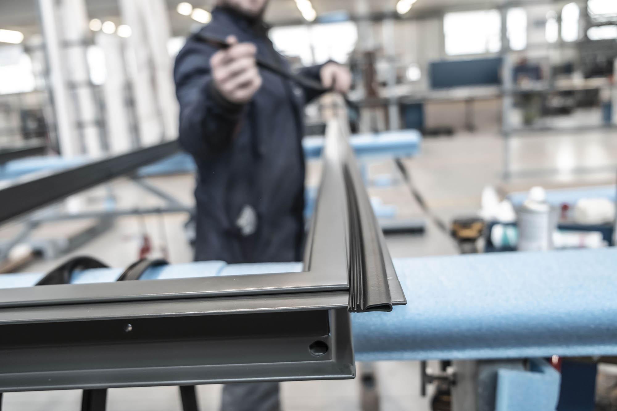 Brombal worker mounting a steel window