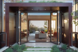 opened metalwood bifold door in a villa