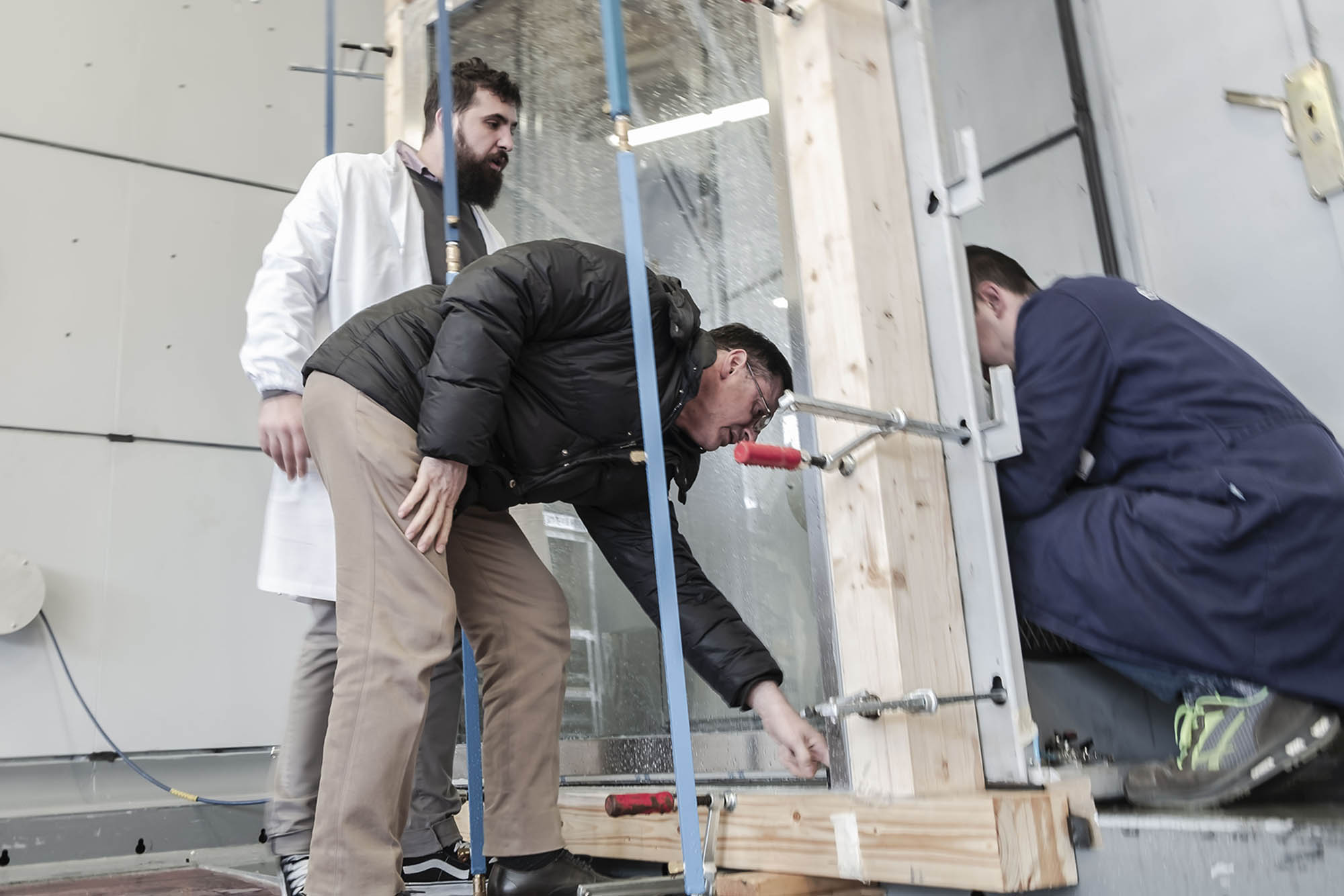 Brombal technicians working on a glass in the testing laboratory